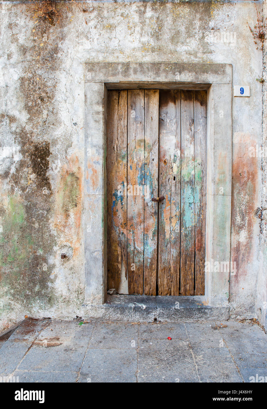 Antique wooden doors with peeling paint in medieval town of Stock ...
