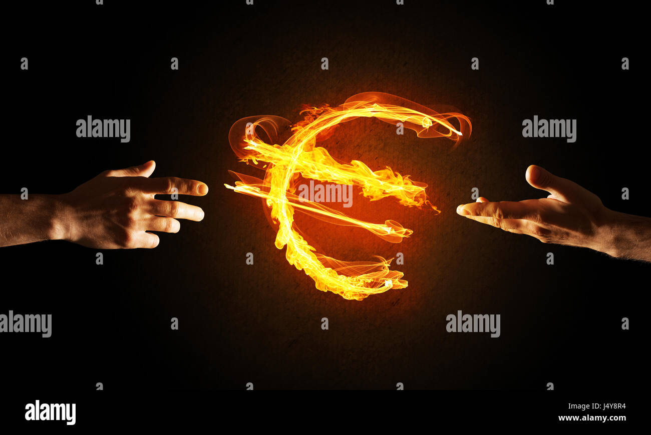 Concept of money making with euro currency fire symbol on dark stock concept of money making with euro currency fire symbol on dark background biocorpaavc Images