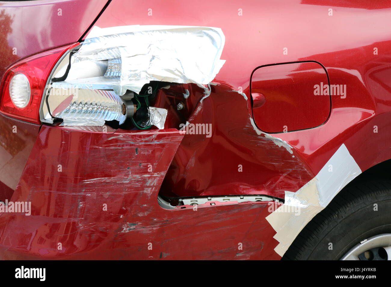 Do it yourself repair job with pipe tape to a rear tail light and Stock Photo, Royalty ...