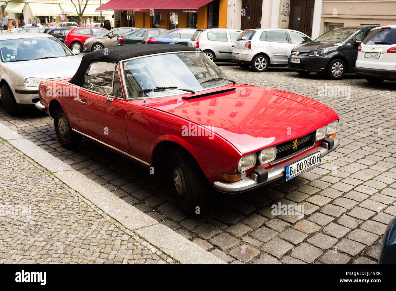 berlin may 3th a vintage red peugeot 504 cabriolet from the 70s stock photo royalty free. Black Bedroom Furniture Sets. Home Design Ideas