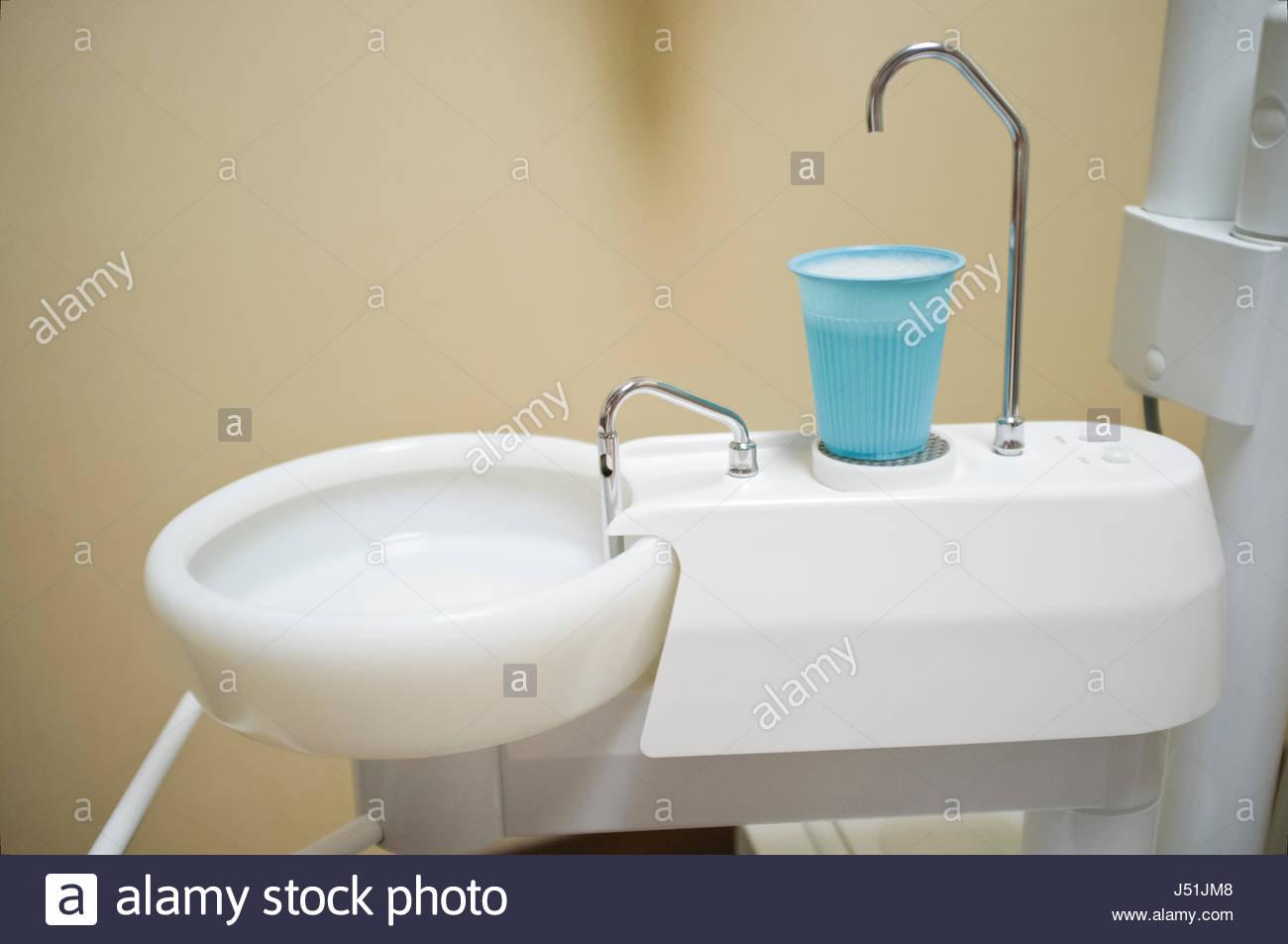 Bathroom Sinks Honolulu small plastic cup and spit sink in dentist office, honolulu, oahu