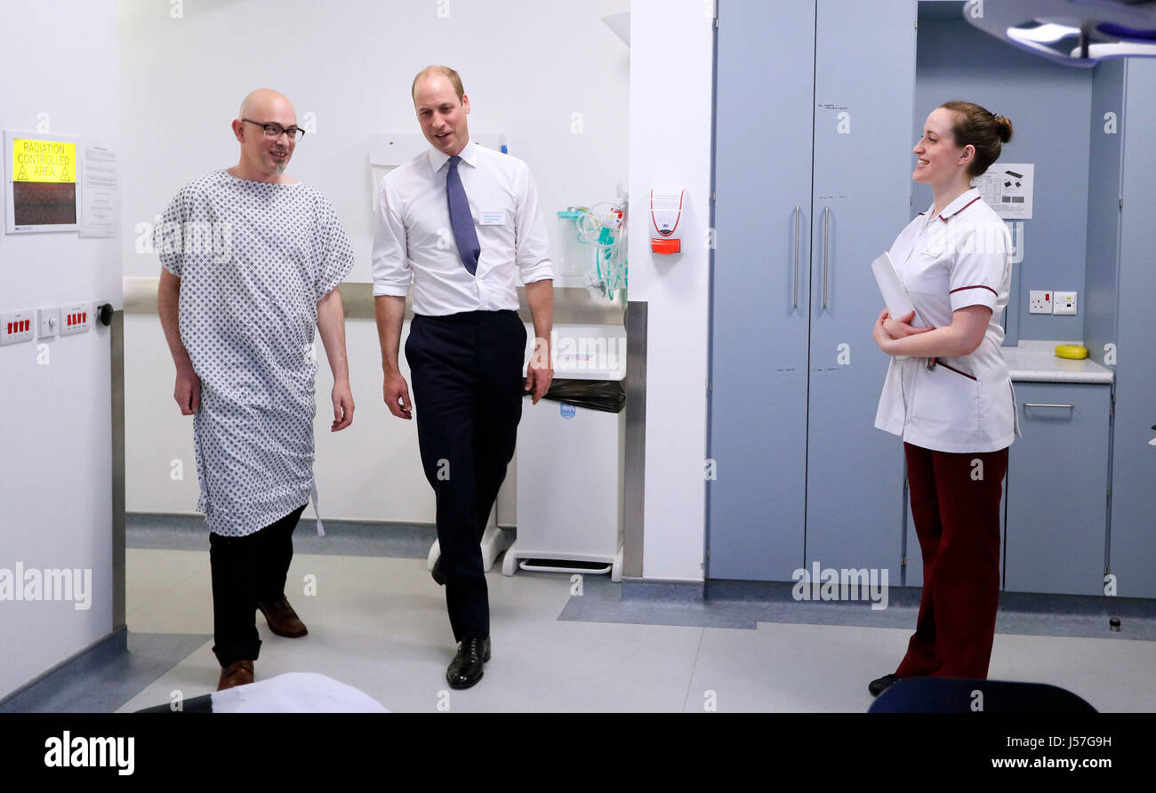 The Duke of Cambridge escorts patient Simon, left, into a radiotherapy  treatment room during a visit to the Royal Marsden NHS Foundation Trust in  Sutton, ...