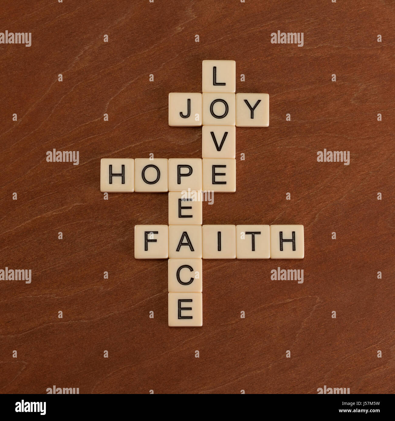 Puzzle peace stock photos puzzle peace stock images alamy crossword puzzle with words faith hope love faith concept ivory tiles with biocorpaavc