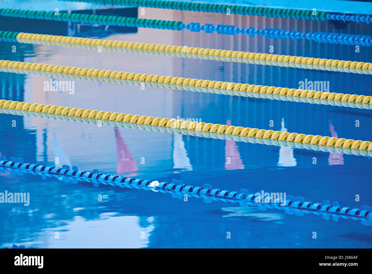 Olympic Swimming Pool Lanes empty olympic swimming pool clear stock photos & empty olympic
