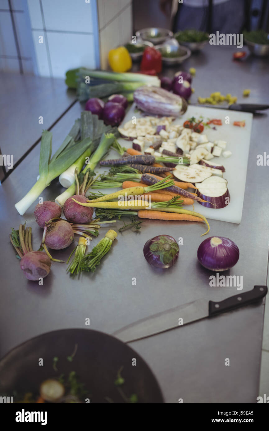 Close Up Of Chopped Vegetables On Kitchen Worktop In Commercial Kitchen
