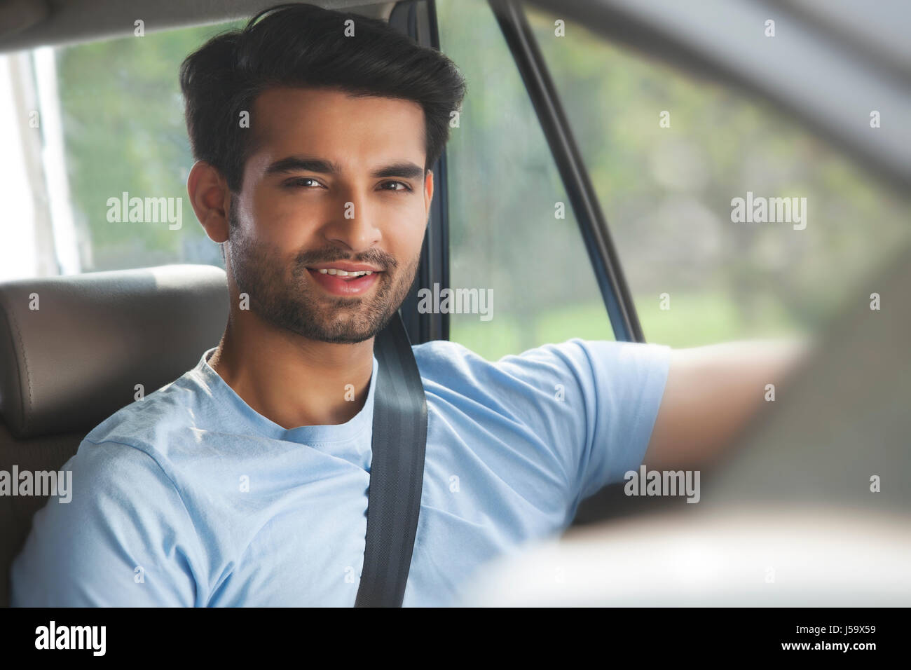 Portrait Of Young Man Sitting In Car   Stock Image
