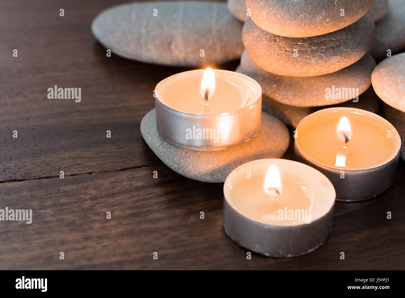 burning candles and pebble stones stock photo 141141673 alamy