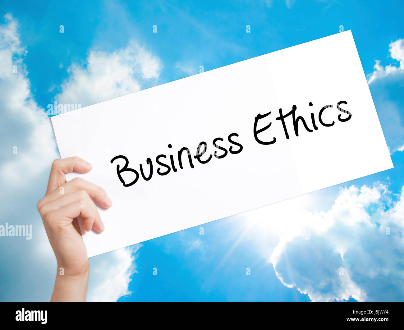 business ethics sign on white paper man hand holding paper  business ethics sign on white paper man hand holding paper text isolated on sky background business concept stock photo