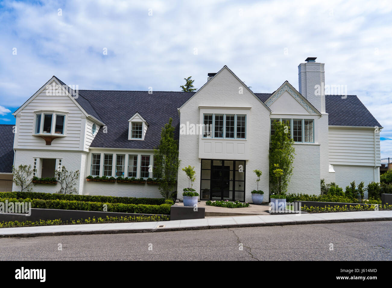 Expensive Suburban White Brick House With Landscaping
