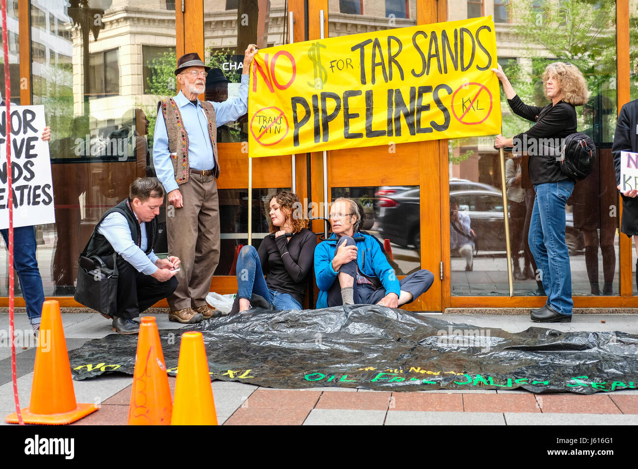 People protesting tar sands pipeline in front of Chase Bank, Seattle,  Washington, US