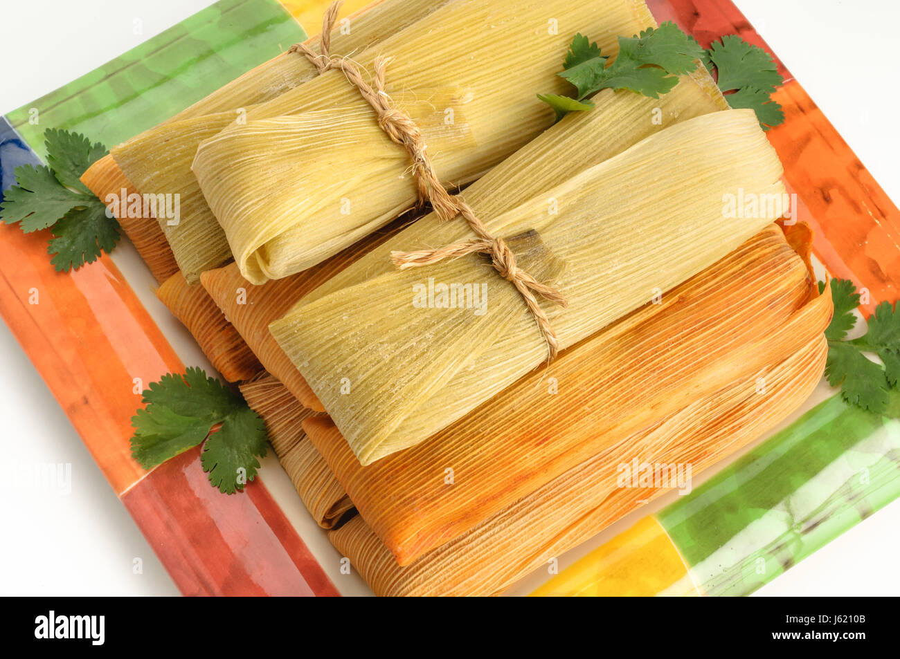 Tamales Mexican Dish Made With Corn Dough Chicken And Chili Stock