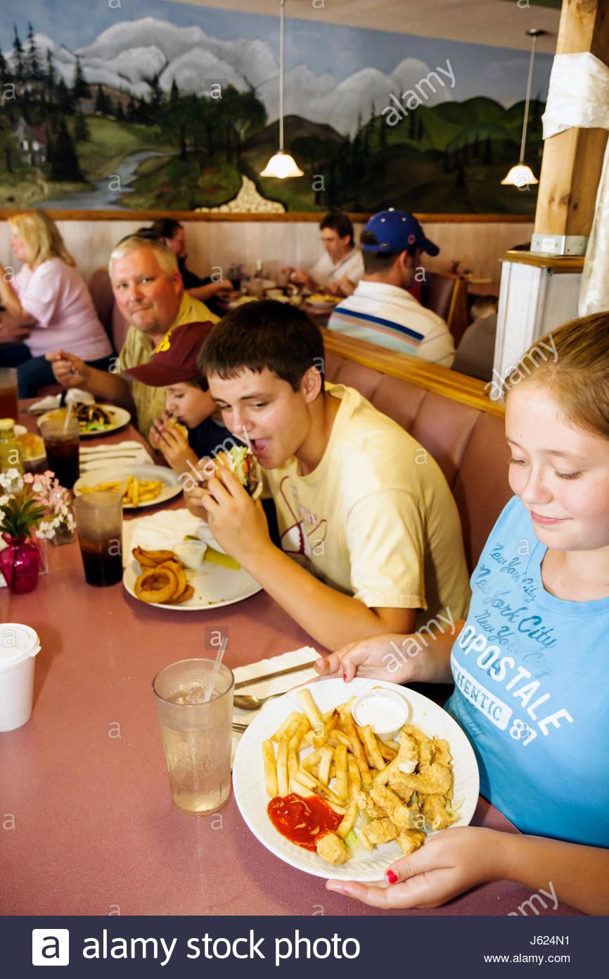 Boy having burger stock photos boy having burger stock for The family room kouts in