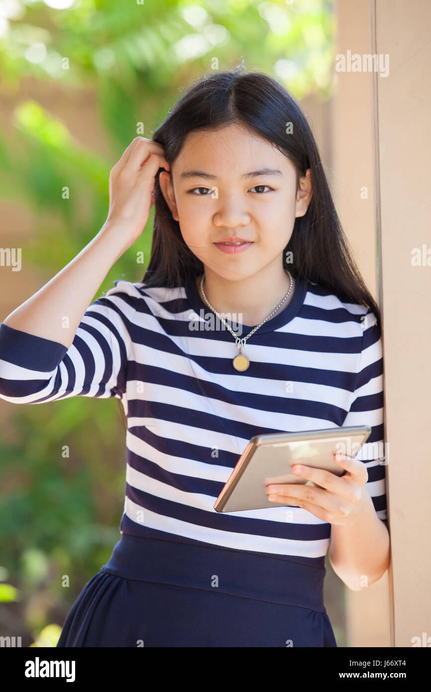 Portrait Of Asian Teen Age ,girl With Computer Tablet In