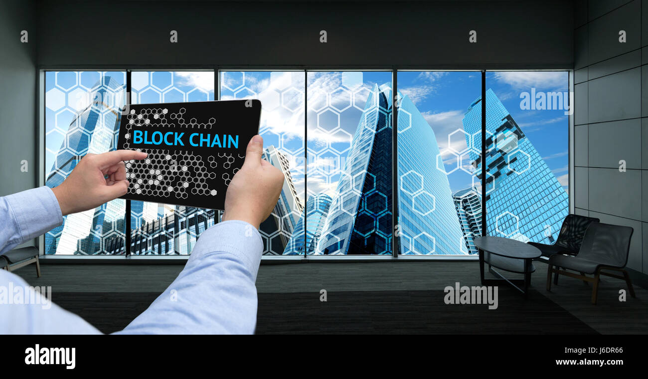 Cryptocurrency Blockchain And Bitcoin Concept Distributed Ledger Technology Man Holding Tablet Block