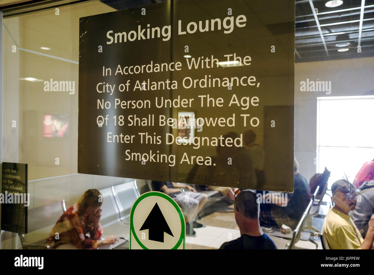 atlanta georgia hartsfield jackson atlanta international airport smoking lounge vice addiction restriction warning stock