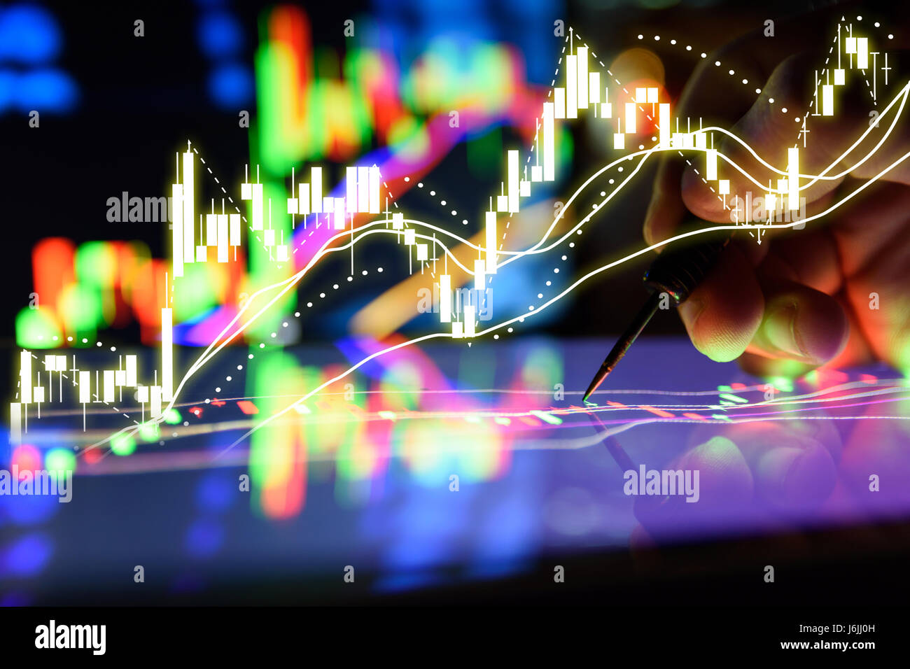 Arrow dart and man finger with graph stock market trading tablet arrow dart and man finger with graph stock market trading tablet screen and laptops lcd monitor background applied as business and stock concept fo voltagebd Images