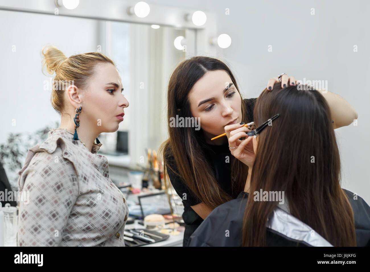 Makeup teacher with her student girl makeup tutorial course at makeup teacher with her student girl makeup tutorial course at beauty school visagiste applying makeup on the eyes makeup master class baditri Image collections