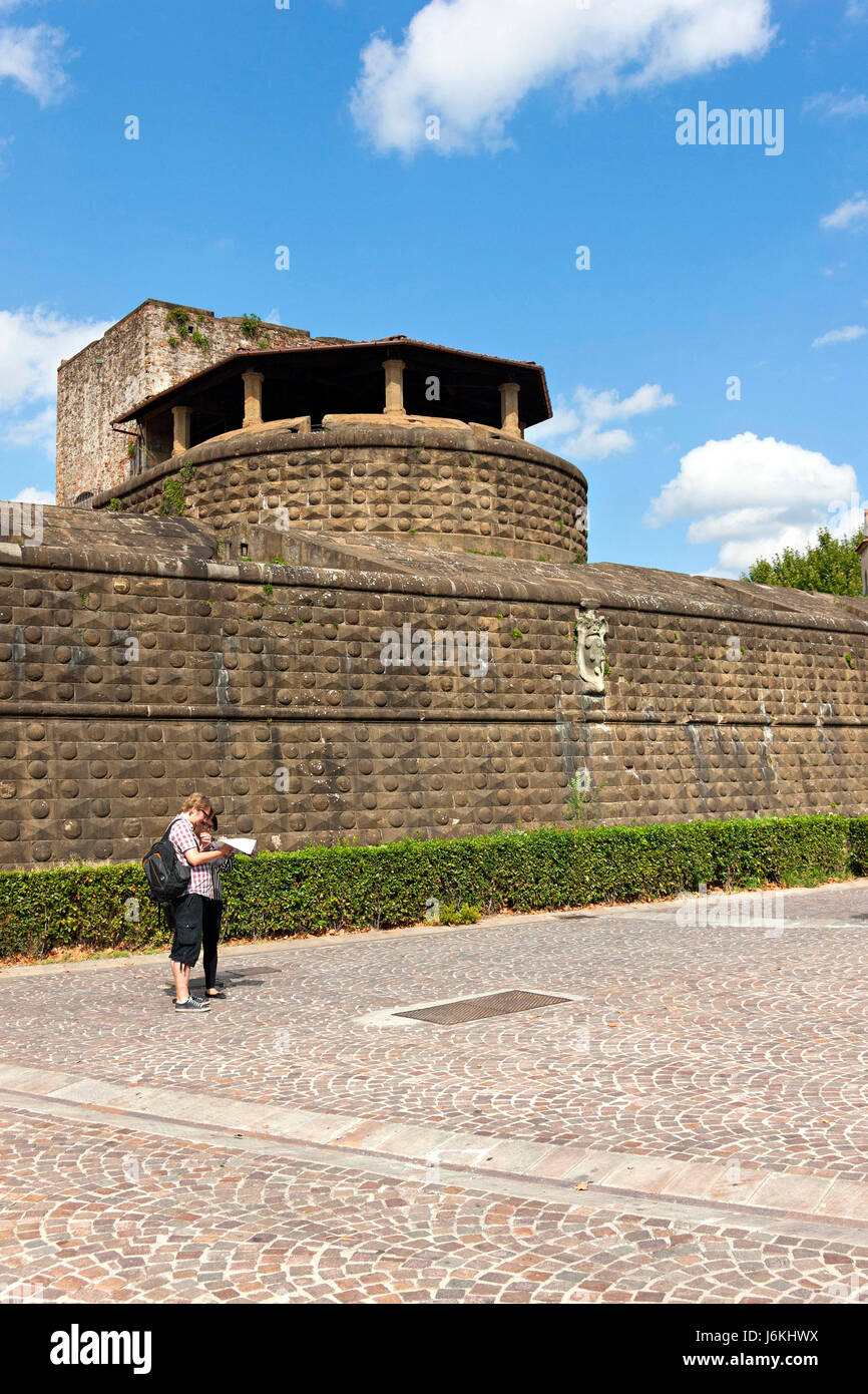 Tourists looking at map outside the fortezza da basso fortezza di tourists looking at map outside the fortezza da basso fortezza di san giovanni battista unesco world heritage site florence italy gumiabroncs Images