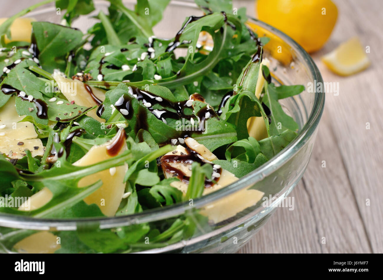 Arugula Rocket Salad Dressed With Balsamic Soy Sauce Parmesan Shavings And Freshly Ground Black Pepper Sesame Horizontal Shot