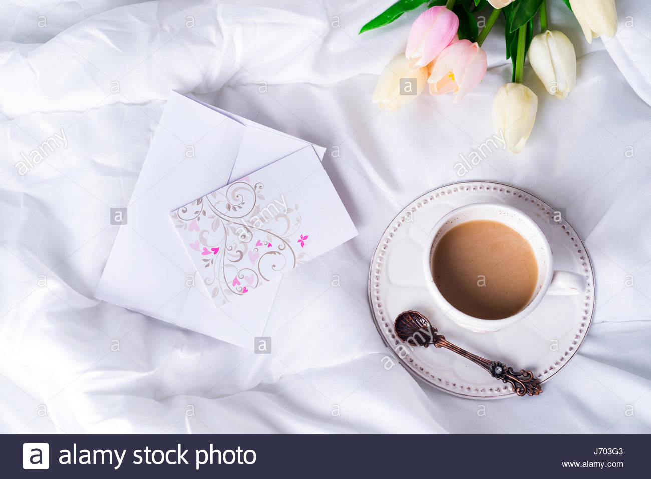 White bed top view - Pink Tulips And Coffee Cup With Letter On White Bed Top View With Copy Space