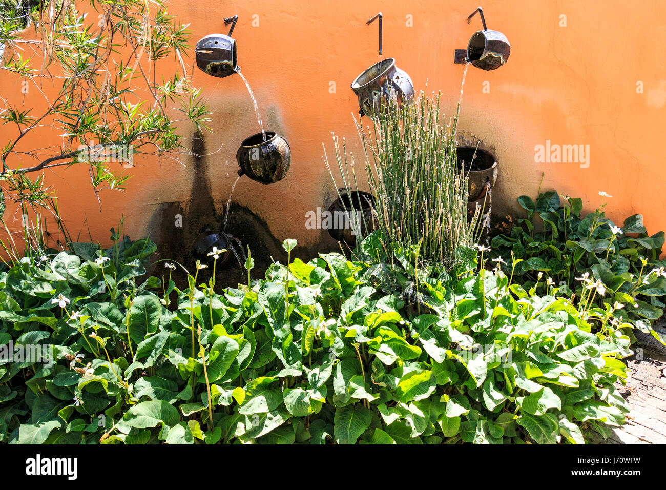 Water Pours From Pot To Pot Along A Wall At Tohono Chul Park, A Beautiful