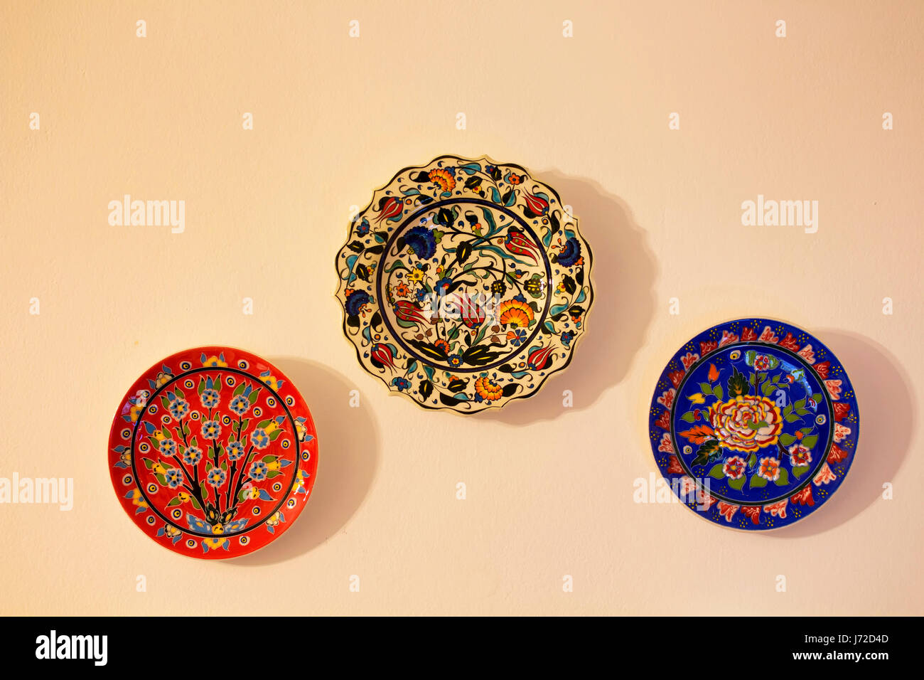 decorative ceramic plates on beige wall traditional turkish ottoman floral motives and patterns are - Decorative Wall Plates