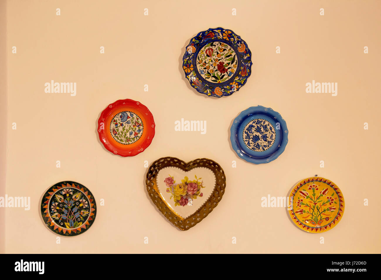 Decorative ceramic plates on beige wall. Traditional Turkish Stock ...