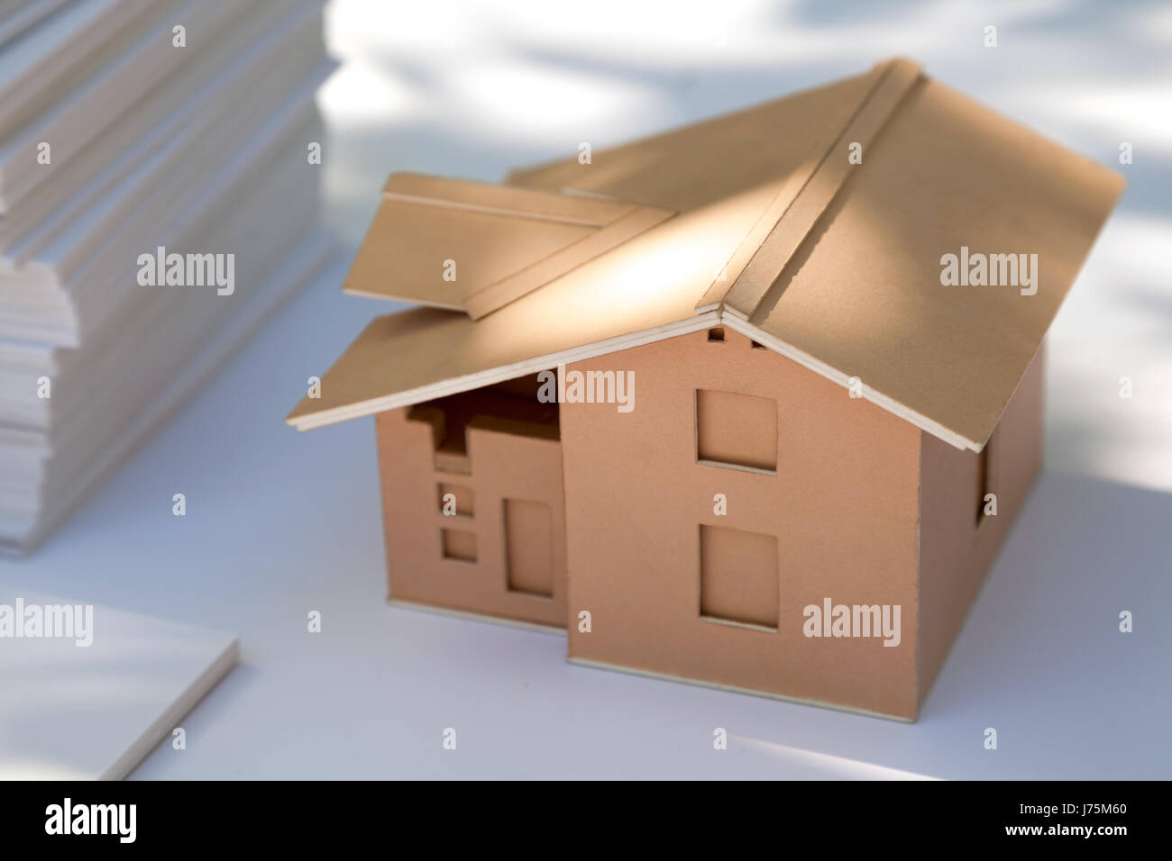 Small cardboard house model on white new home design for for Architecture models for sale