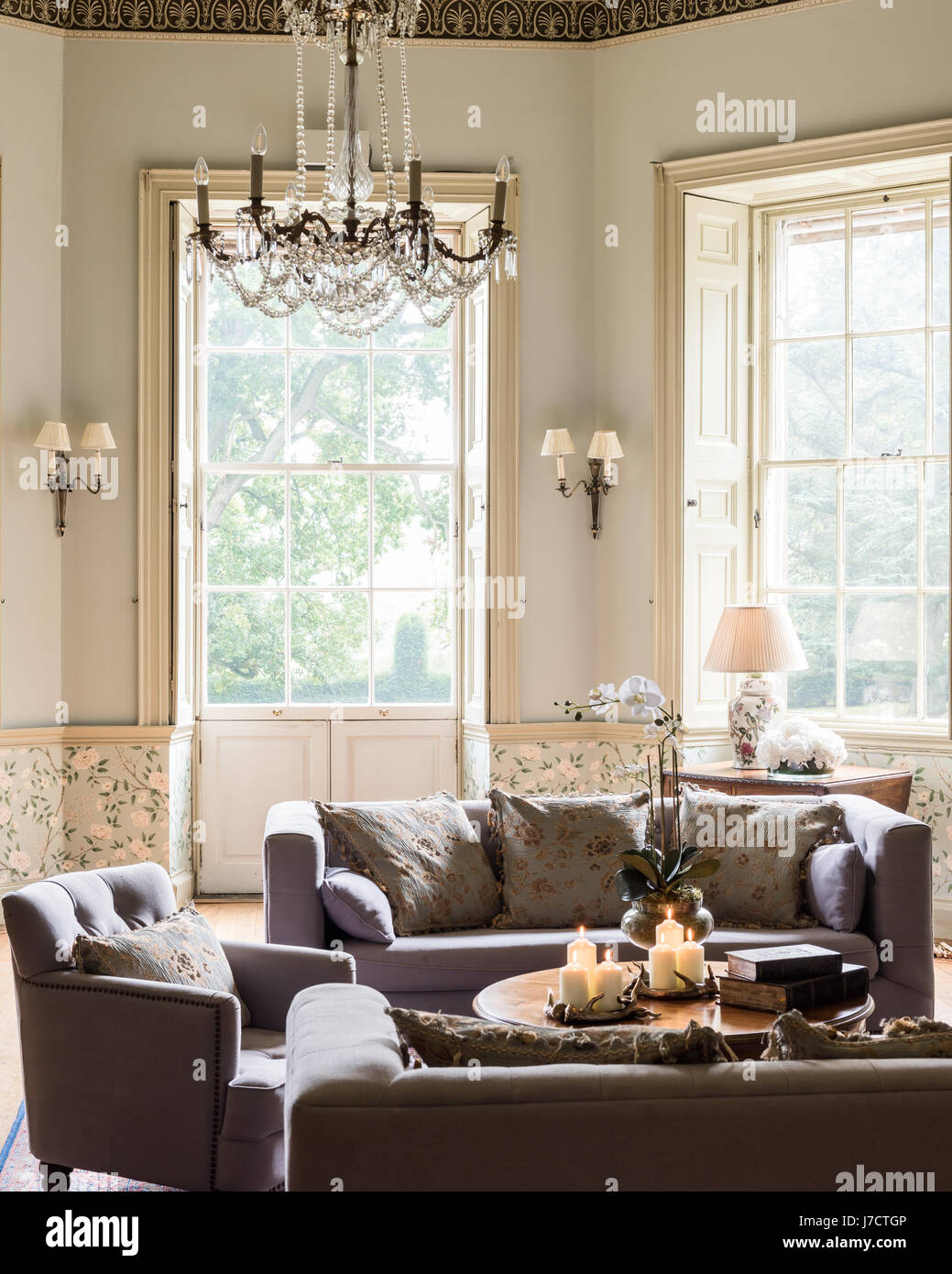 Cosy candles on coffee table in drawing room with sofas and cosy candles on coffee table in drawing room with sofas and armchair from made geotapseo Images