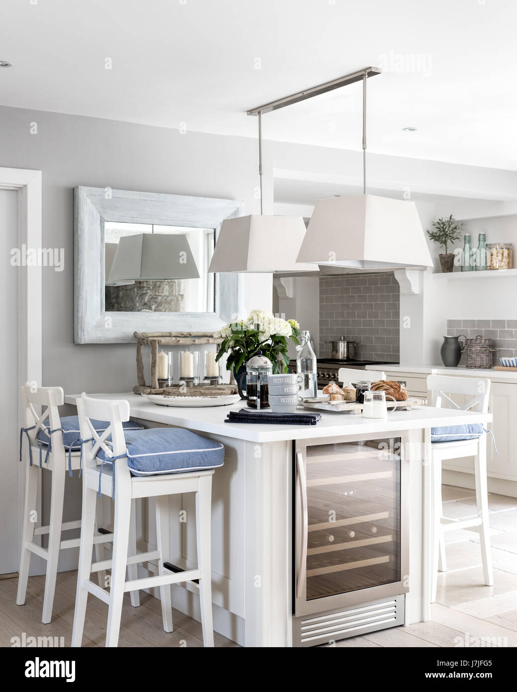 breakfast bar with white ingolf bar stools from ikea and chambray stock photo royalty free. Black Bedroom Furniture Sets. Home Design Ideas