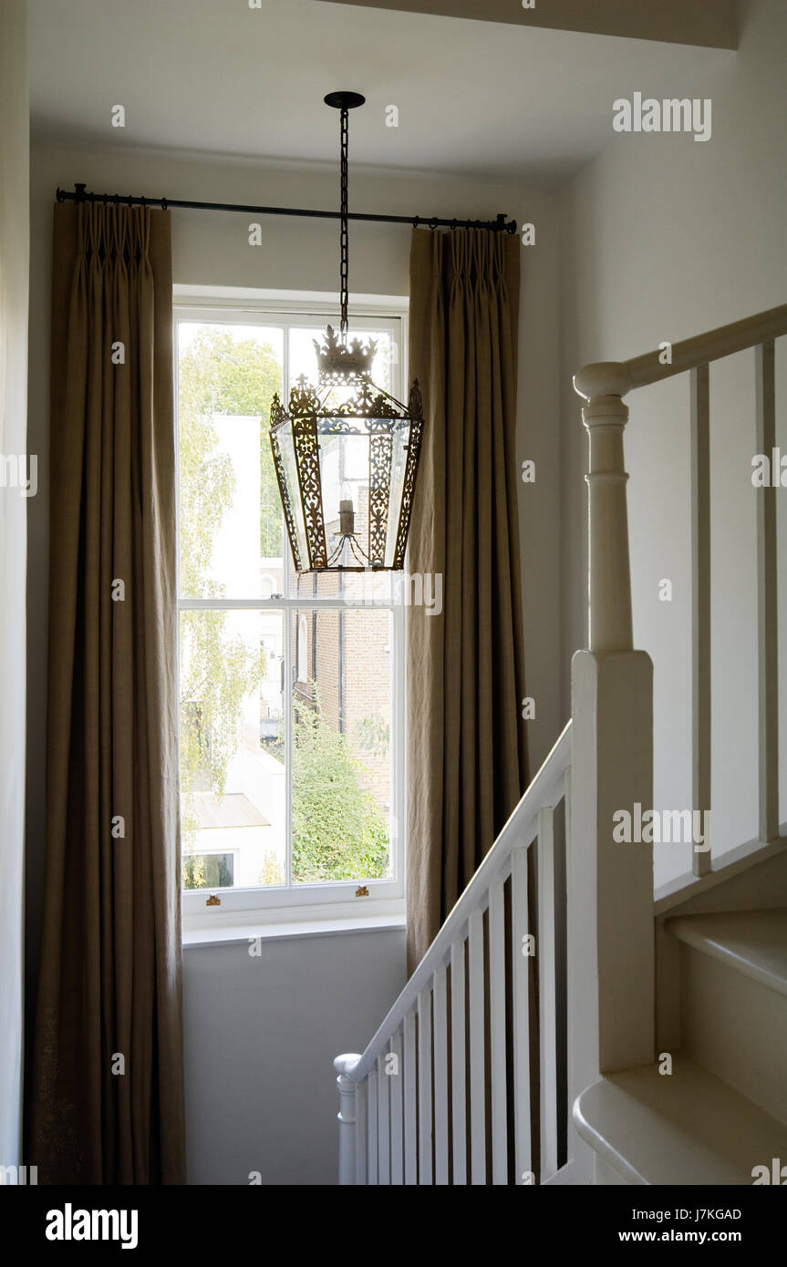 Lantern Hangs Above Staircase With Fulllength Curtains In Portland Road,  London, UK Gallery