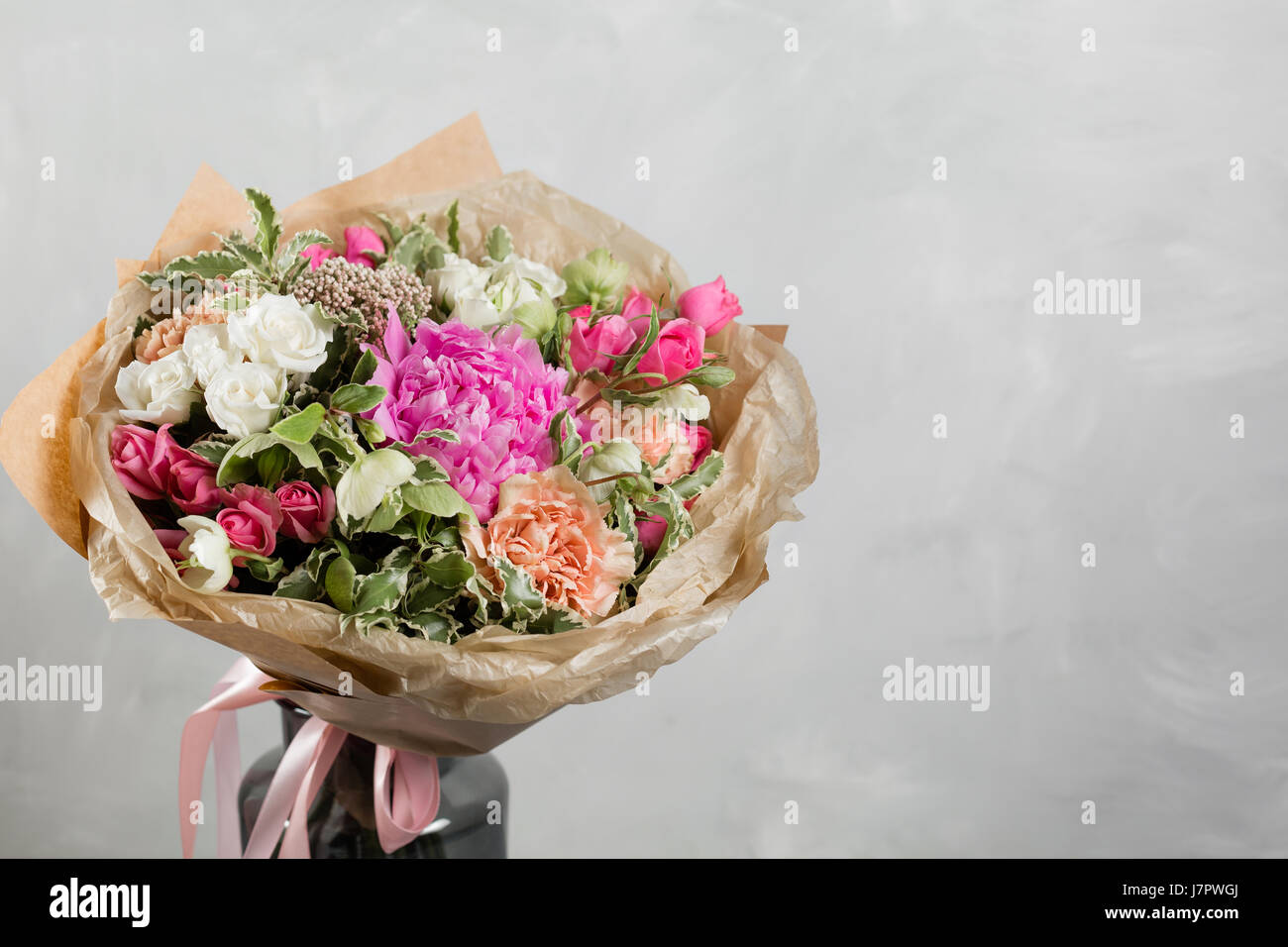 Bouquet of different flowers in a mixed arrangement against gray bouquet of different flowers in a mixed arrangement against gray wall on background copy space izmirmasajfo Gallery