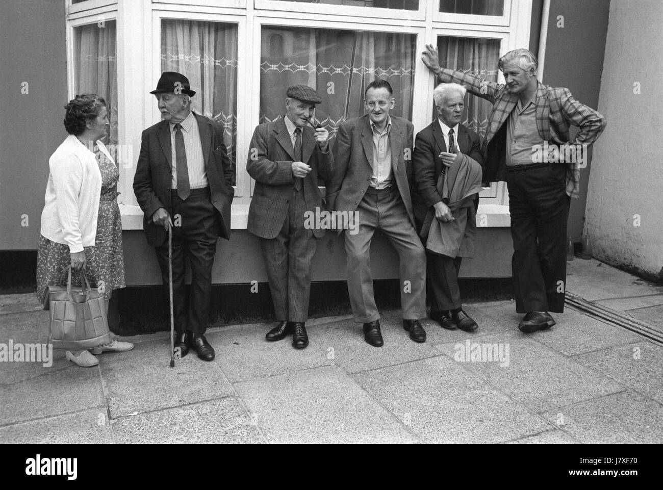 Group of men friends friendship village life uk 1970s holsworthy devon england 1975 men at the pretty maid of holsworthy annual folklore country custom