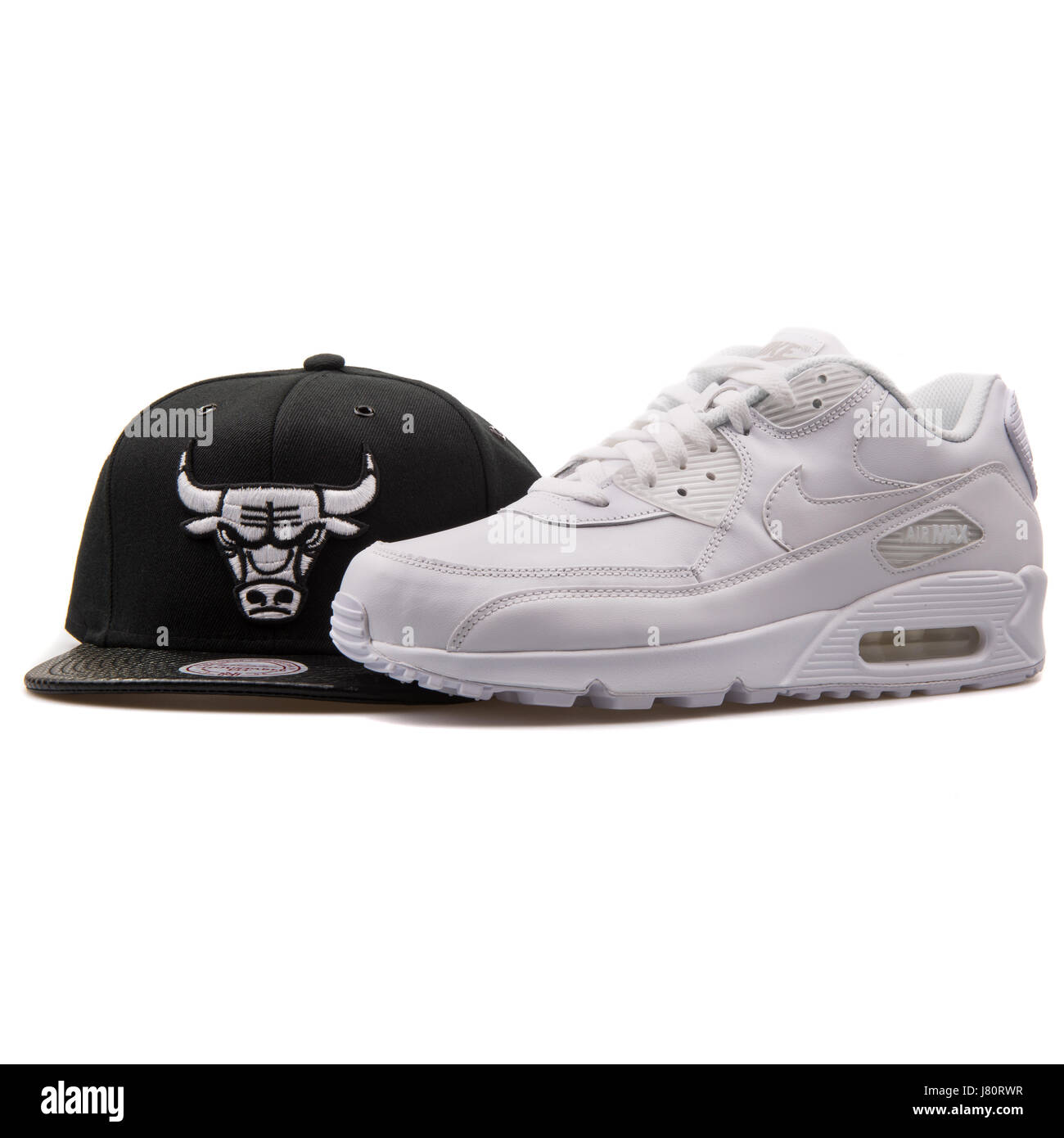 White Nike Air Max Sneaker and Black Mitchell & Ness Chicago Bulls Cap