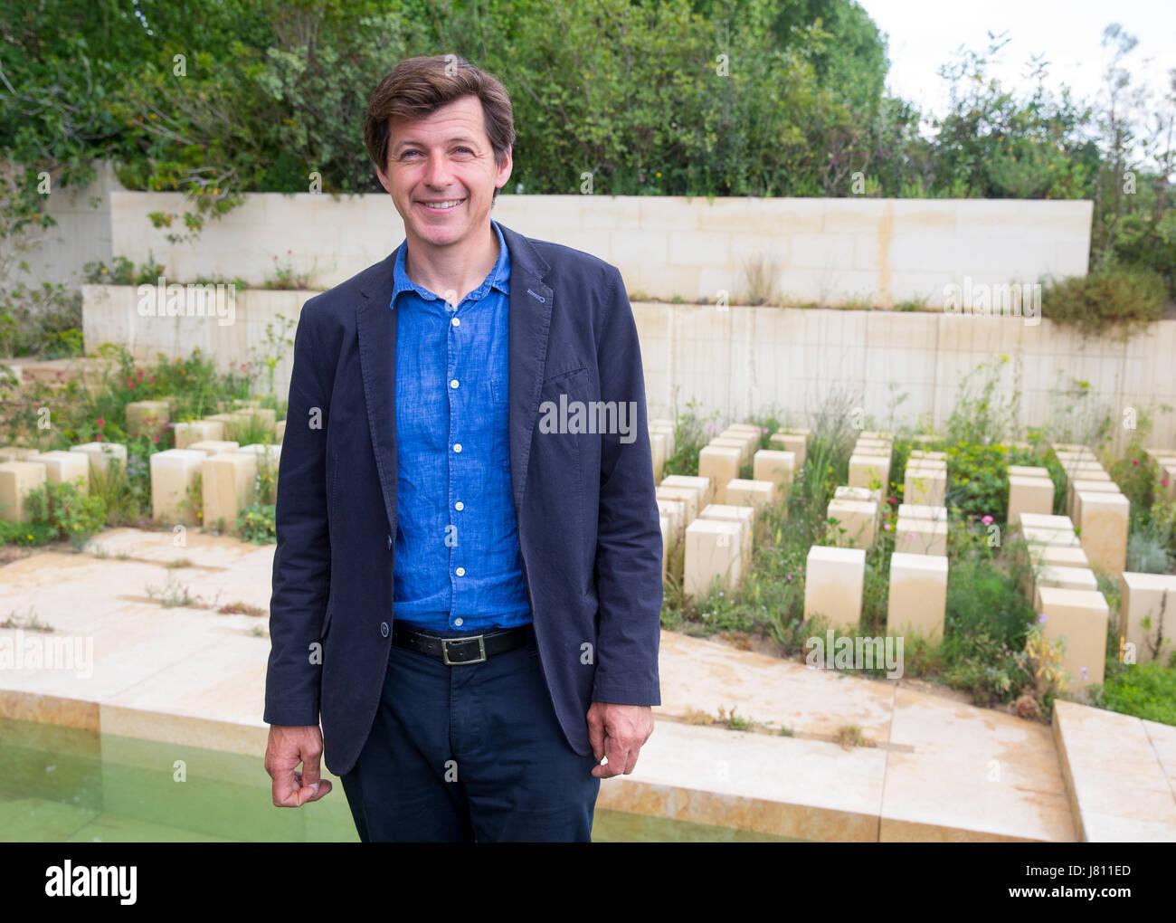garden designer, james basson, standing the best in show at rhs