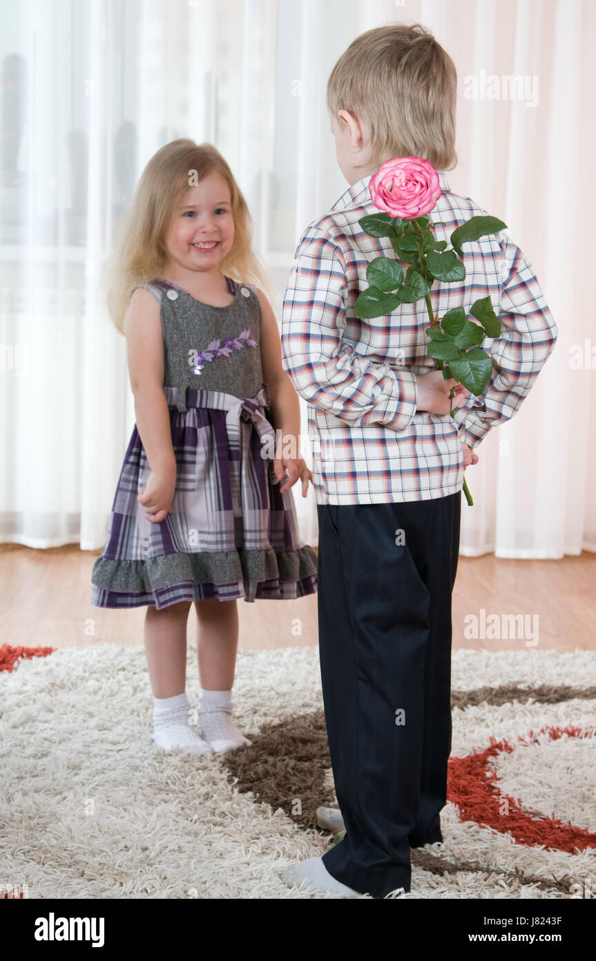 youngster girls Stock Photo - flower plant rose gift boy lad male youngster couple pair girl  girls child
