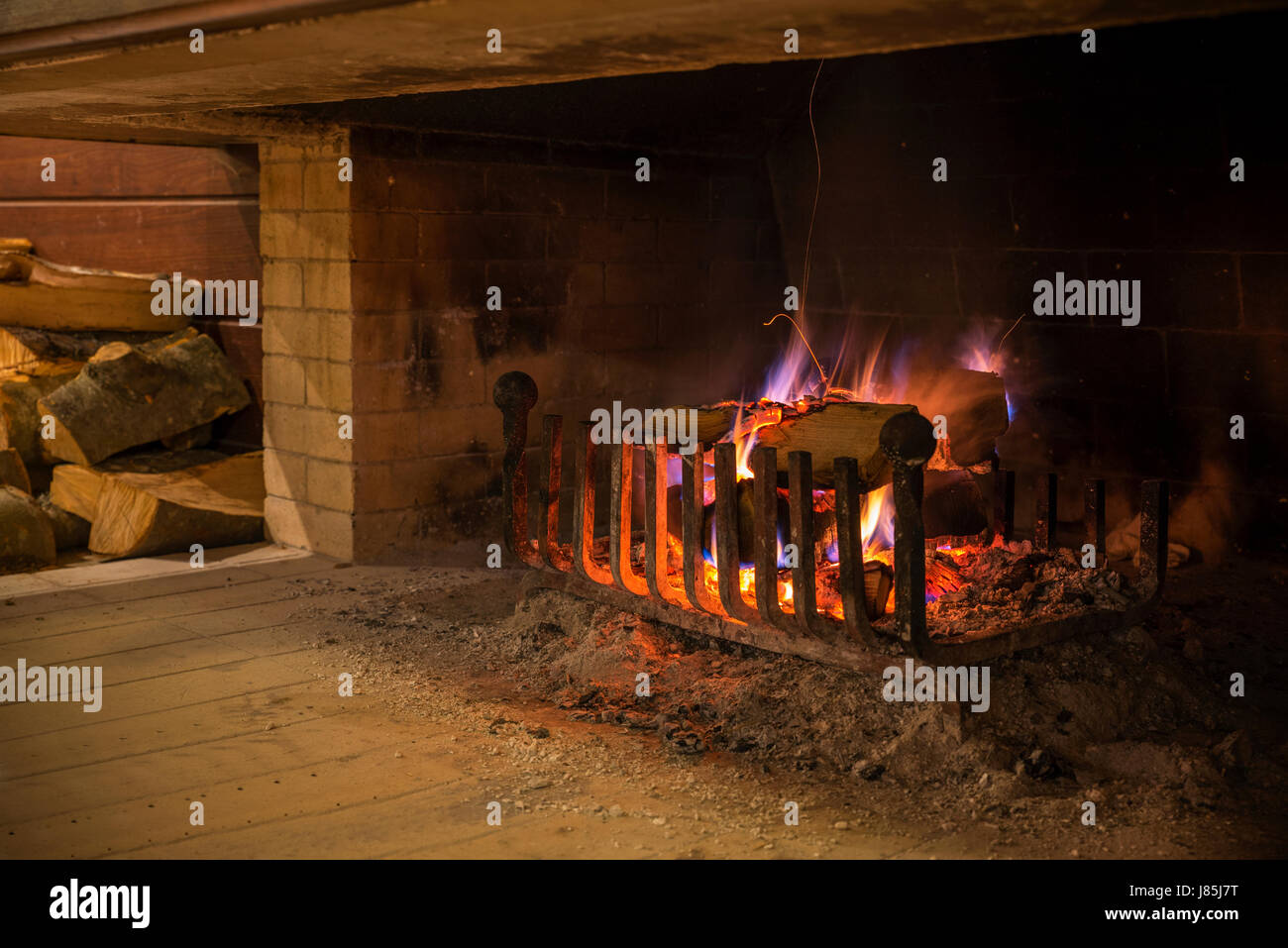 wood burn in the fireplace in the house winter idyll stock photo