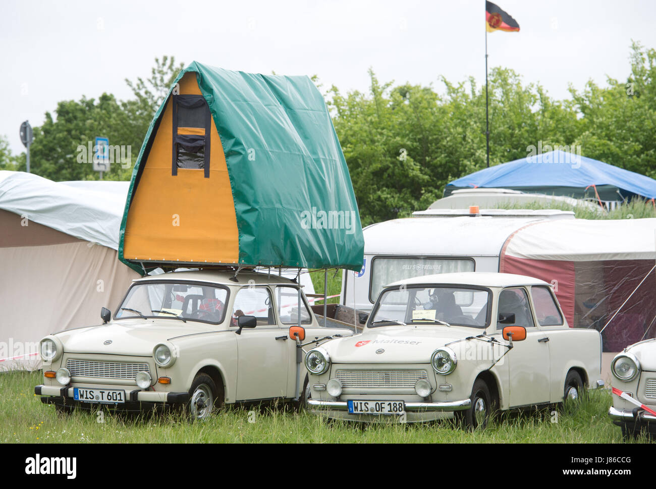 A trabant with a car roof tent can be seen on the premises of the International Trabant Gathering in Anklam Germany 24 May 2017. Around 1000 lovers of the ... & A trabant with a car roof tent can be seen on the premises of the ...