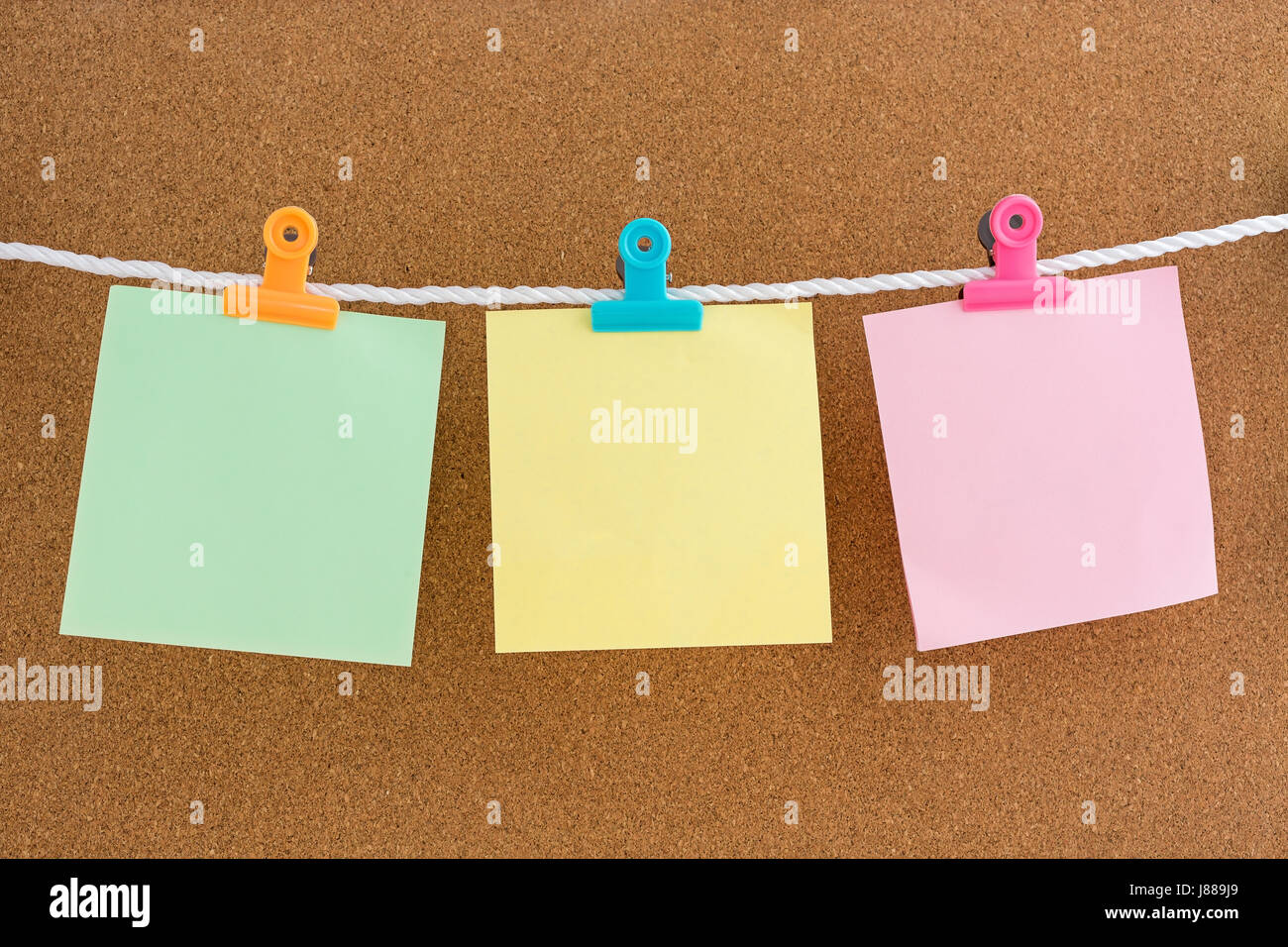 blank notes with letter clips on cork bulletin board