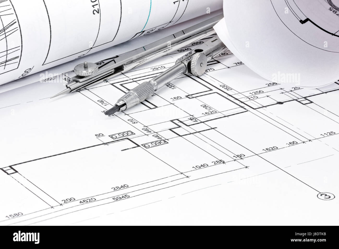 Rolls of architecture blueprint with drawing compass closeup view rolls of architecture blueprint with drawing compass closeup view malvernweather Image collections