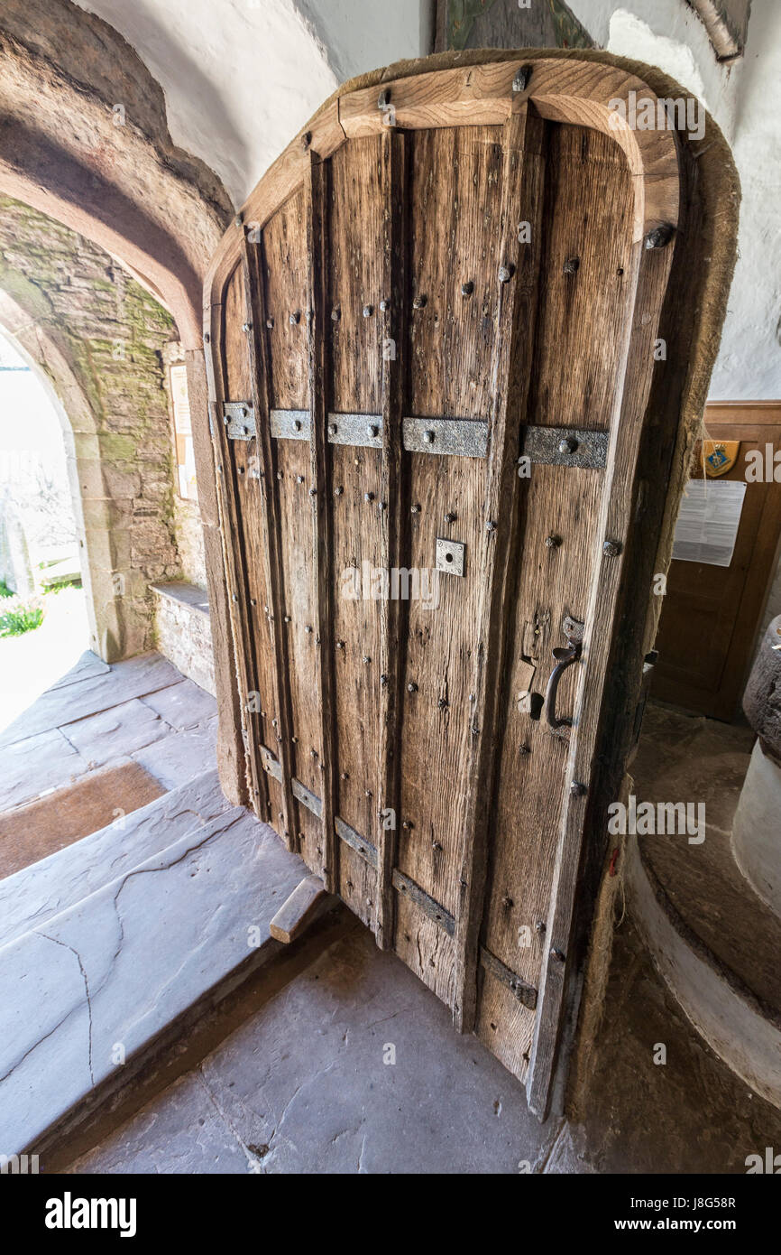Studdied Oak Wooden Door To Patricio (Partrishow) Church Of St Issui,  Powys, Wales, UK