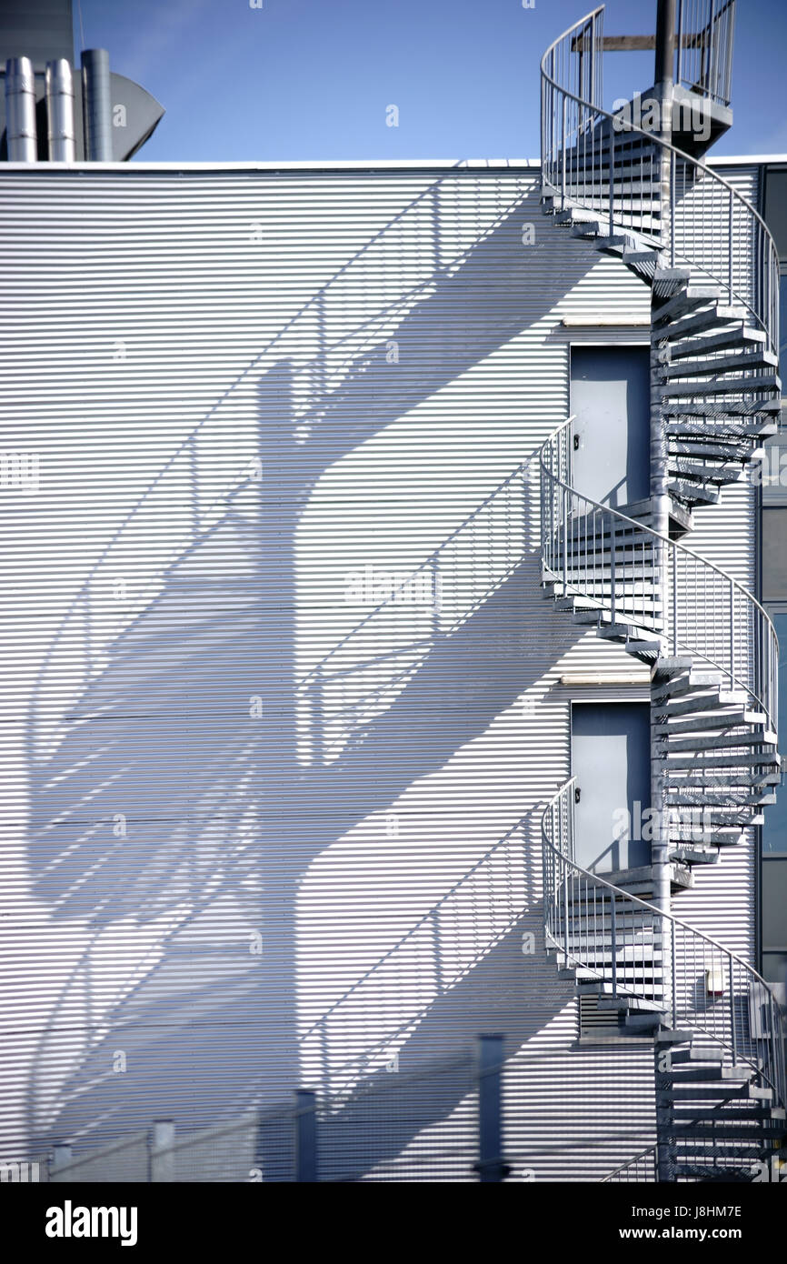 Perfect A Spiral Staircase, Fire Escape On The Side Of A Industrial Building Facade