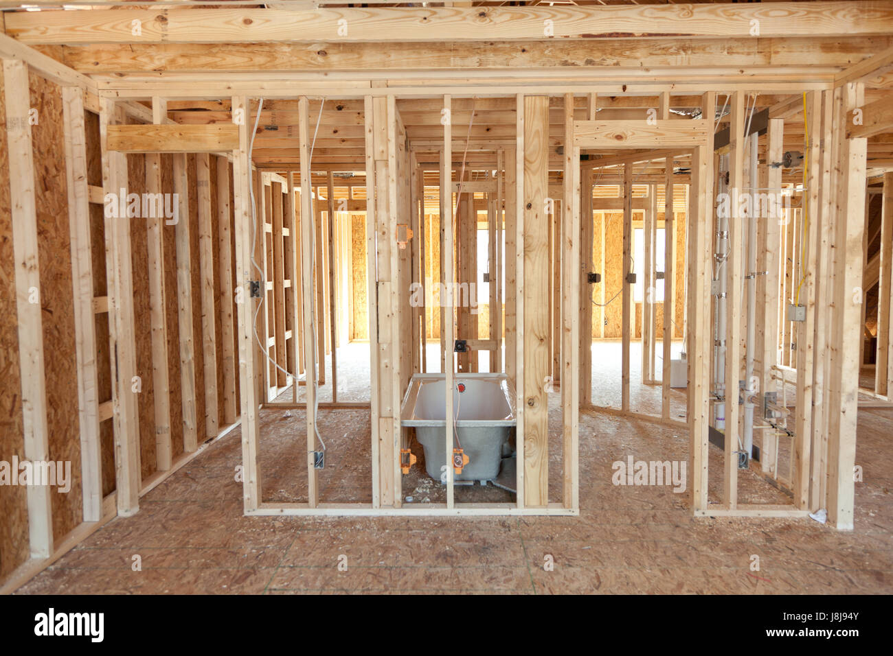 New Home Construction With Plumbing Pipes In The Walls