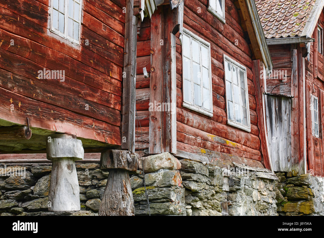 traditional norwegian wooden red colored cabin houses facades