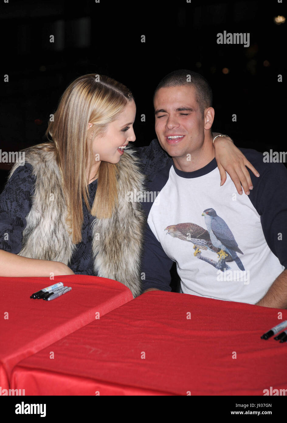 dianna agron and mark salling at the glee season one cd