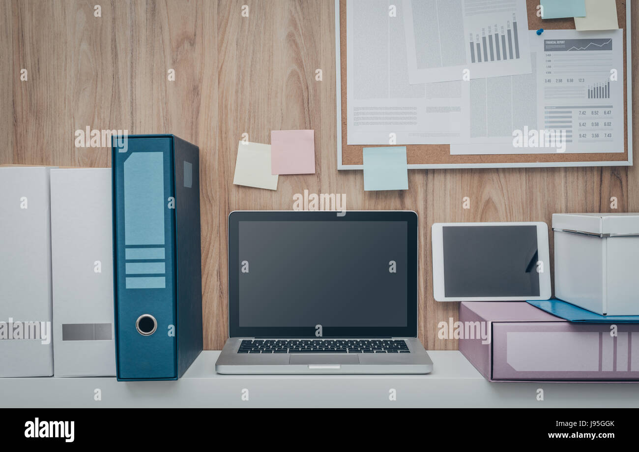office pinboard. laptop and folders on a shelf in the office pinboard background business workspace technology