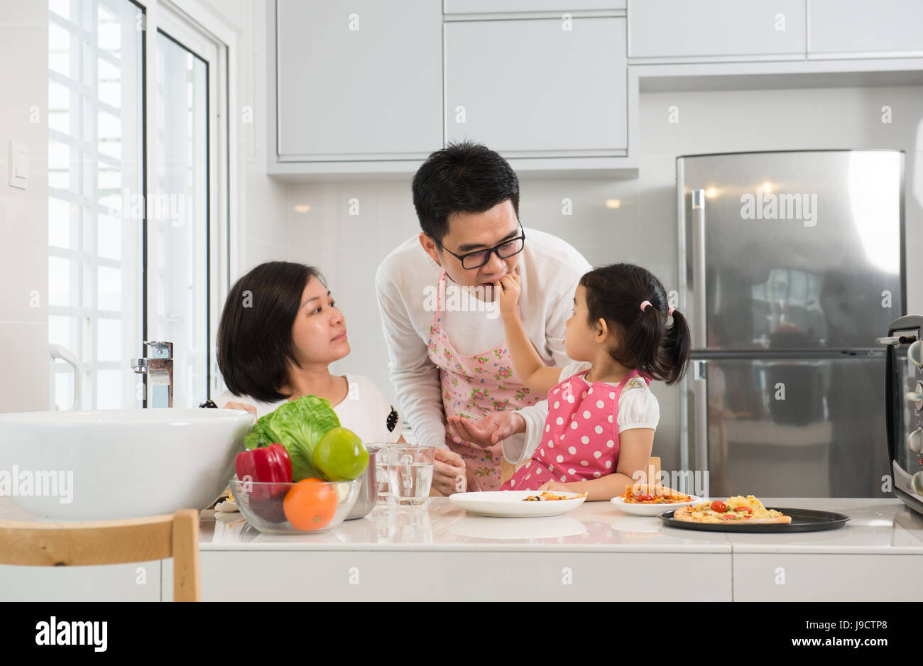 Family cooking kitchen - Stock Photo Asian Family Cooking At Kitchen