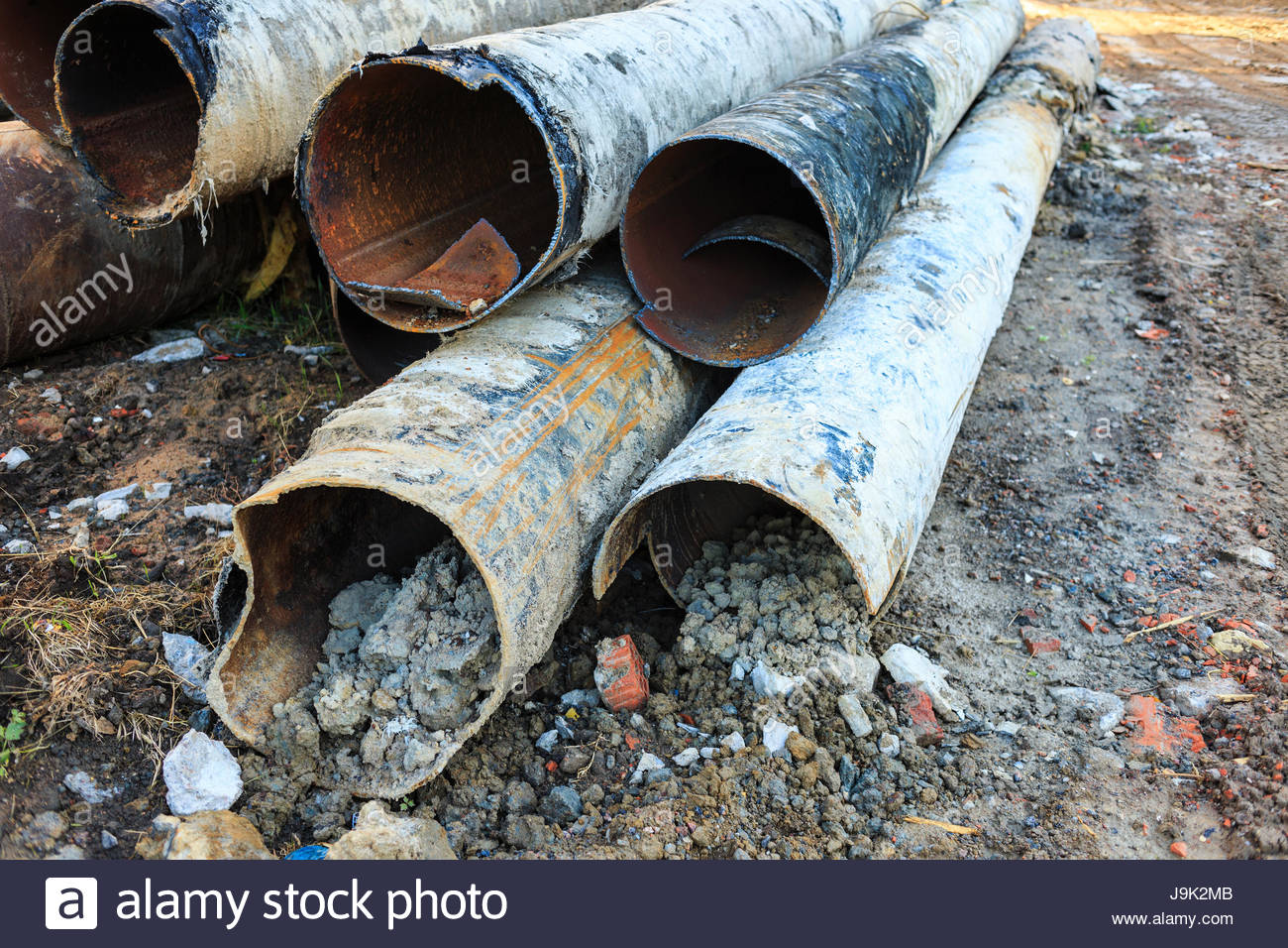 Dismantle the old water pipes lying next to the trench for What are old plumbing pipes made of