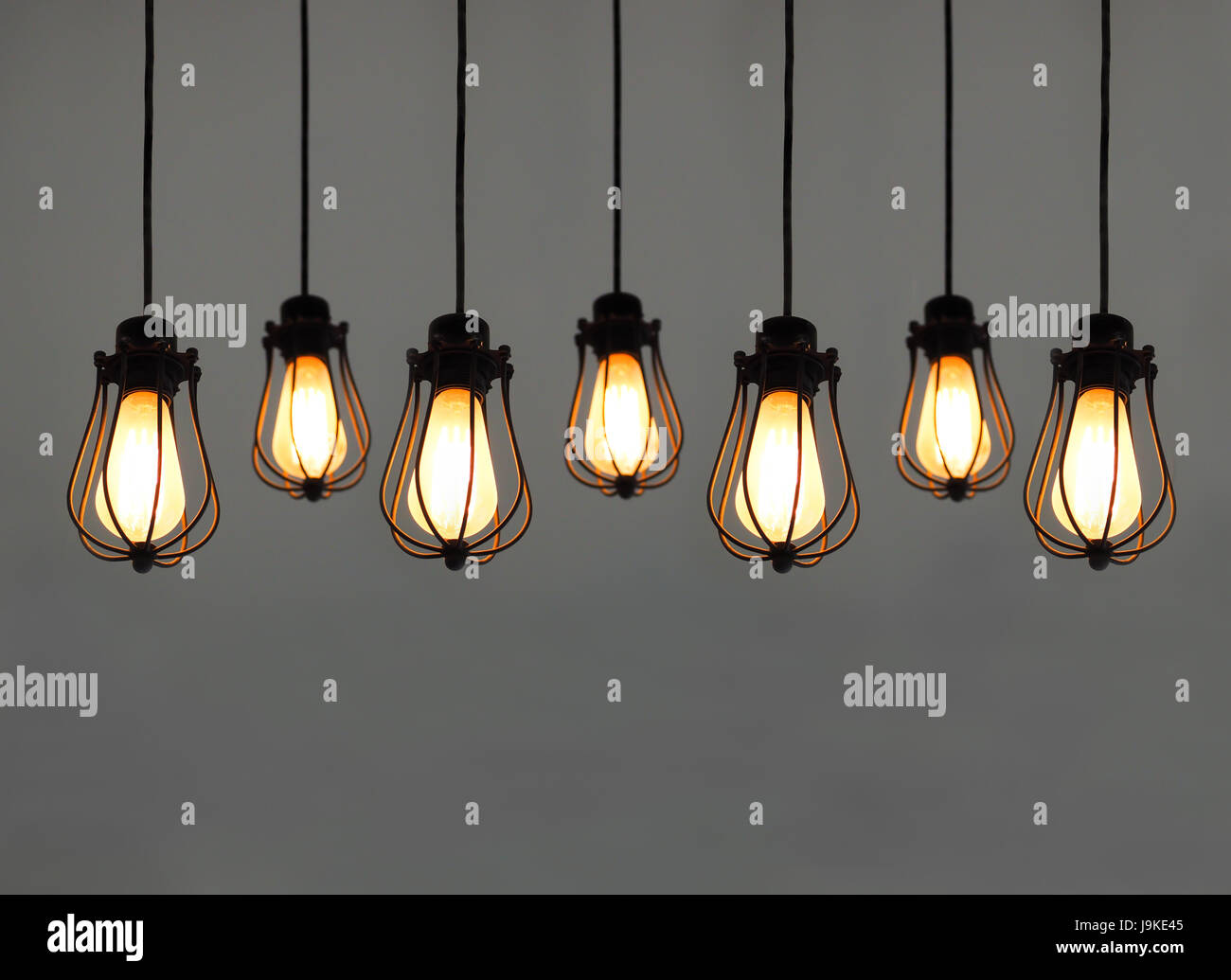 beautiful hanging light bulbs on plain background for card banner wallpaper