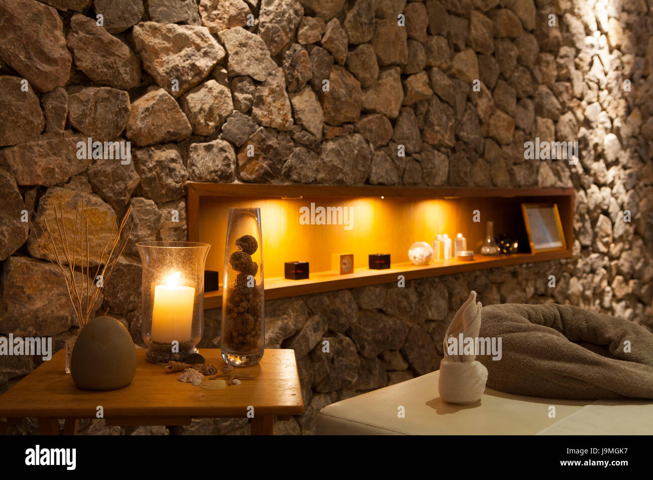 interior of modern massage room in candle light romantic spa room